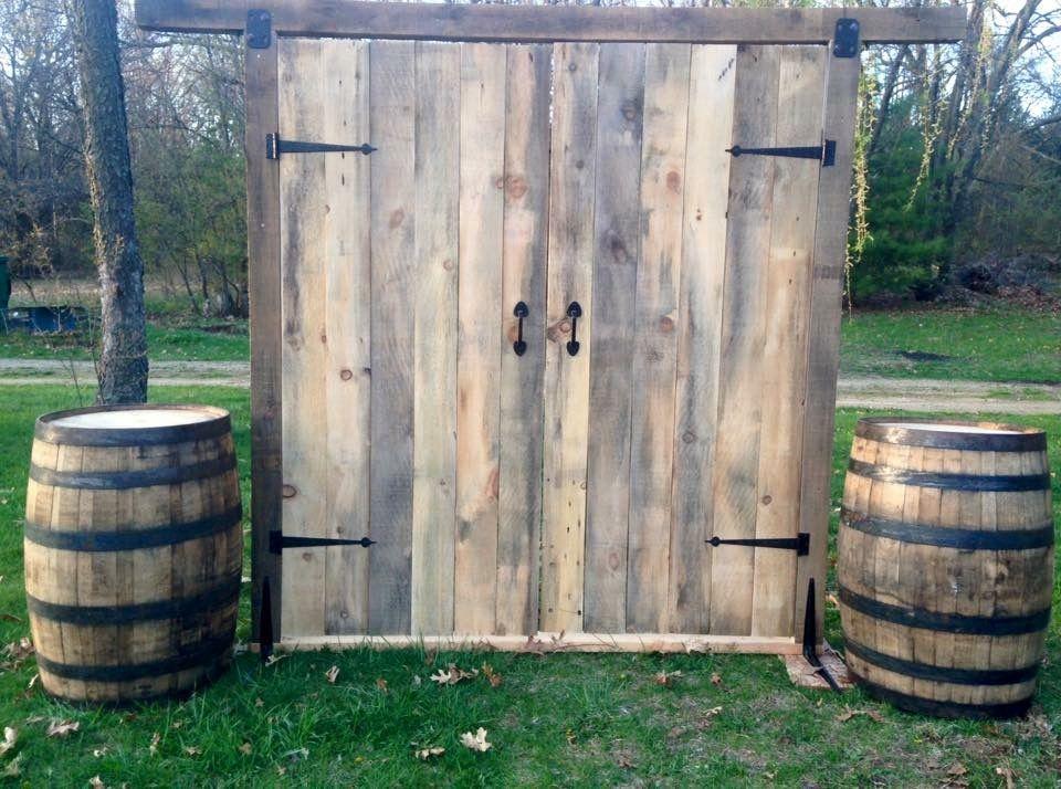 Barn Door Ceremony Backdrop For Wedding And Whiskey Barrels