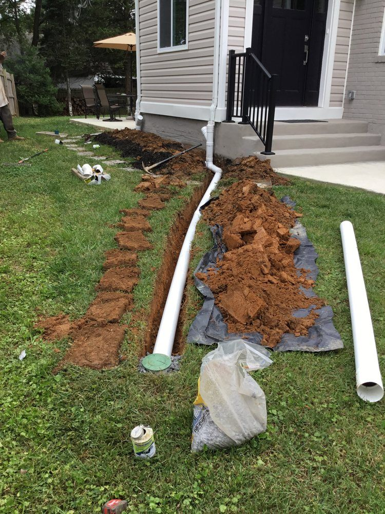 Photo Of Vm Drainage Erosion Solutions Manassas Va United States Downspout Extension With Pop Up Drain Downspout Outdoor Decor Photo