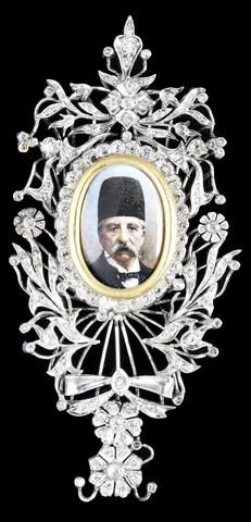 An interesting and fine diamond-set platinum Insignia depicting the prominent Persian modernist Mirza Malkom Khan (1833-1908) styled on the Qajar Order of the Imperial Effigy, England, circa 1880
