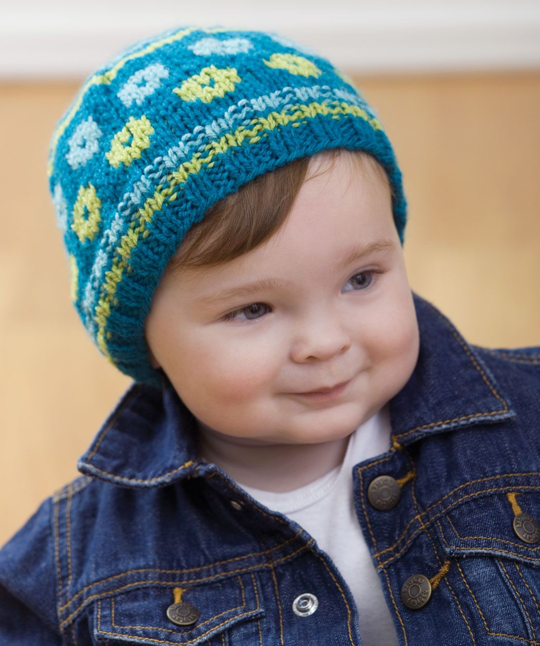 Knit Intarsia Baby Hat Knitting Pattern A little bit of color goes a ...