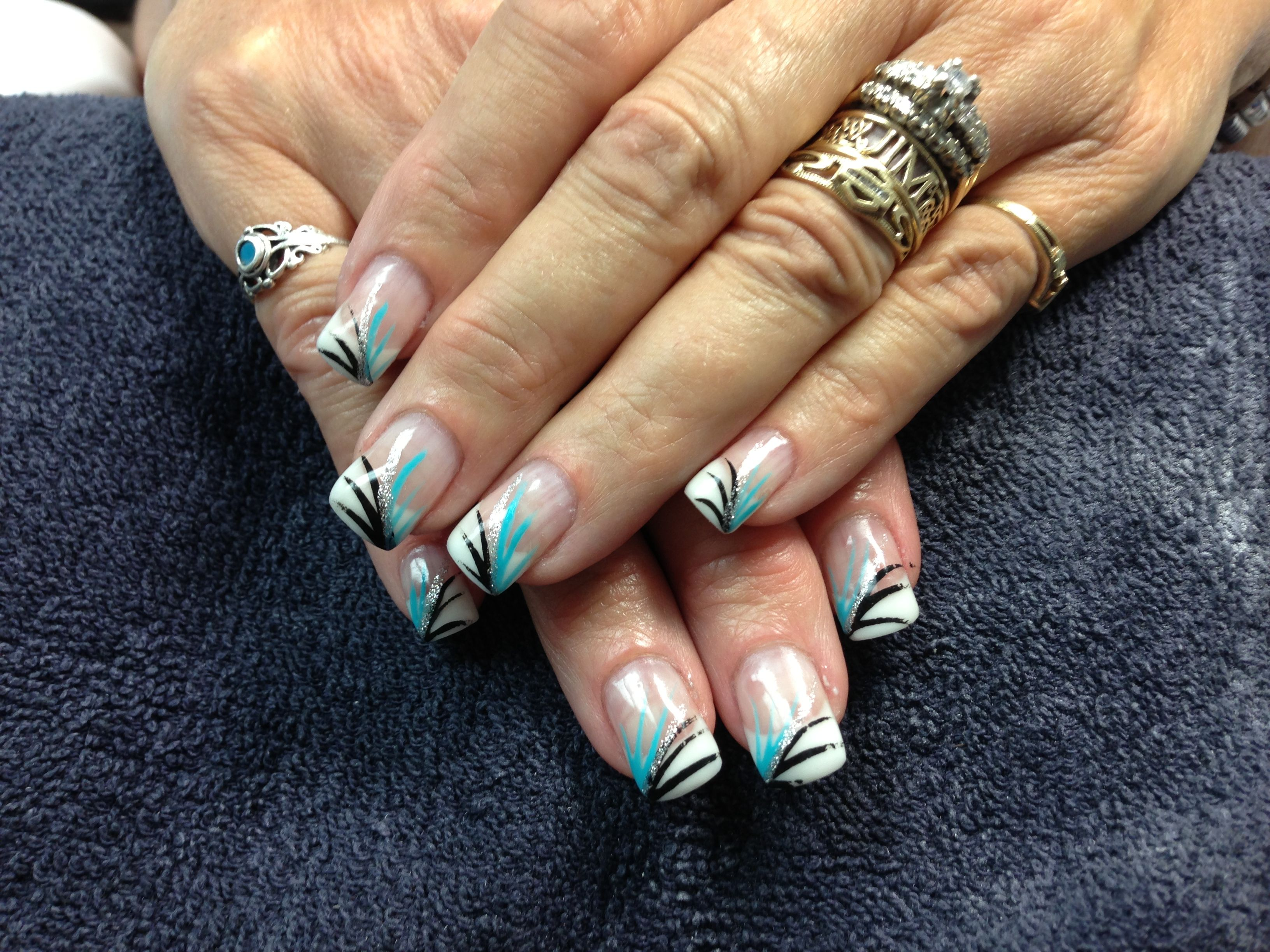Mandy\u0027s nails. White tips with teal, black and silver. Gel