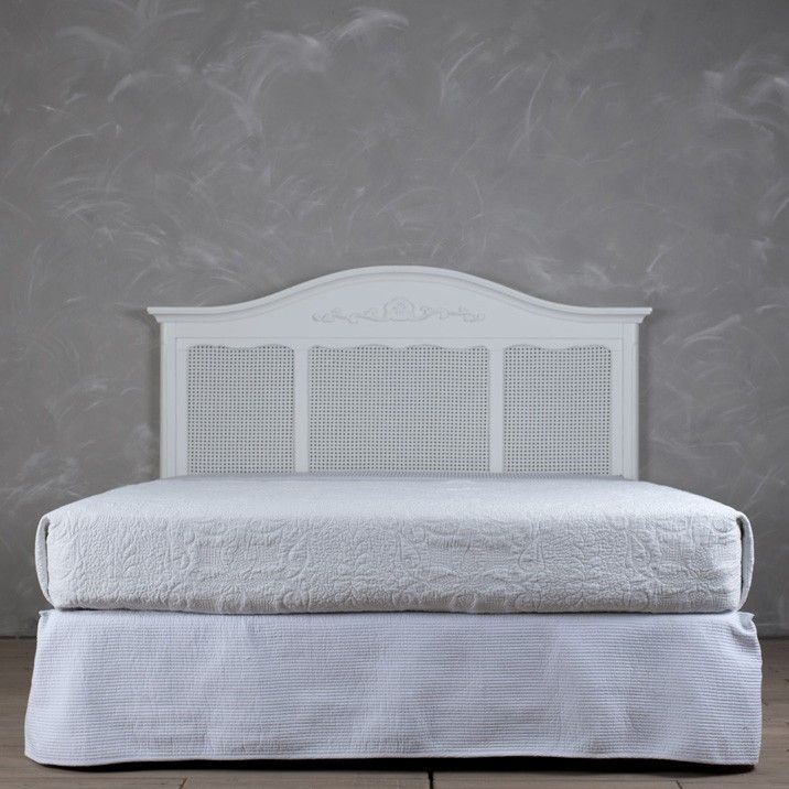 White rattan bed head