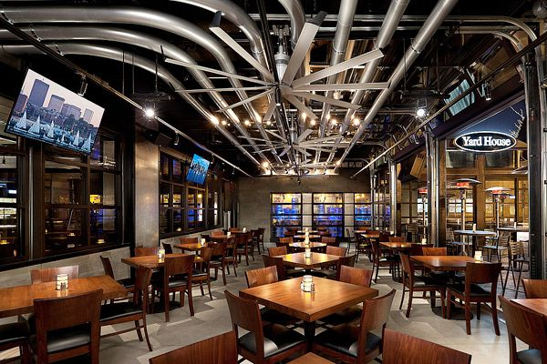 Check out this beauty- the editorial says: Alameda, Calif.-based MBH Architects created Yard House, which opened in March. The 12,000-sq.-ft. space engages guests with big screen TVs, which display games played at Boston's Fenway Park. The space also features aluminum conduits that transport beer above guests, as well as expansive fans from Big Ass Fans.   Credit: Photos courtesy of Misha Bruk…