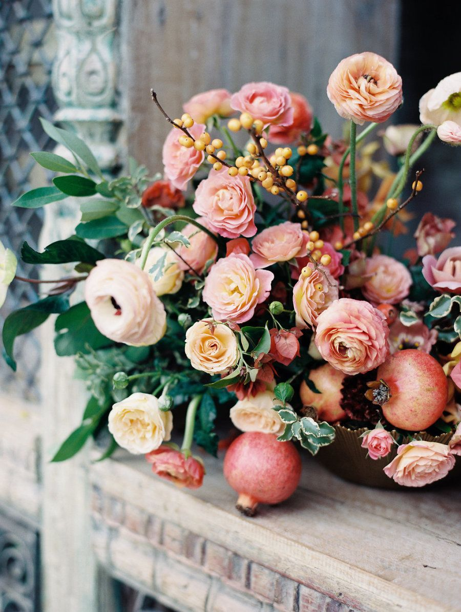 Pink bougainvillea and ranunculus wedding flowers: Photography : Ashley Slater Photography Read More on SMP: http://www.stylemepretty.com/2017/03/03/the-ultimate-inspiration-for-a-colorful-boho-style-wedding/