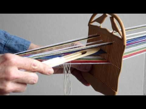 VIDEO: Weaving narrow bands with a double holed heddle. Idea: string heddles UNDER the warp.