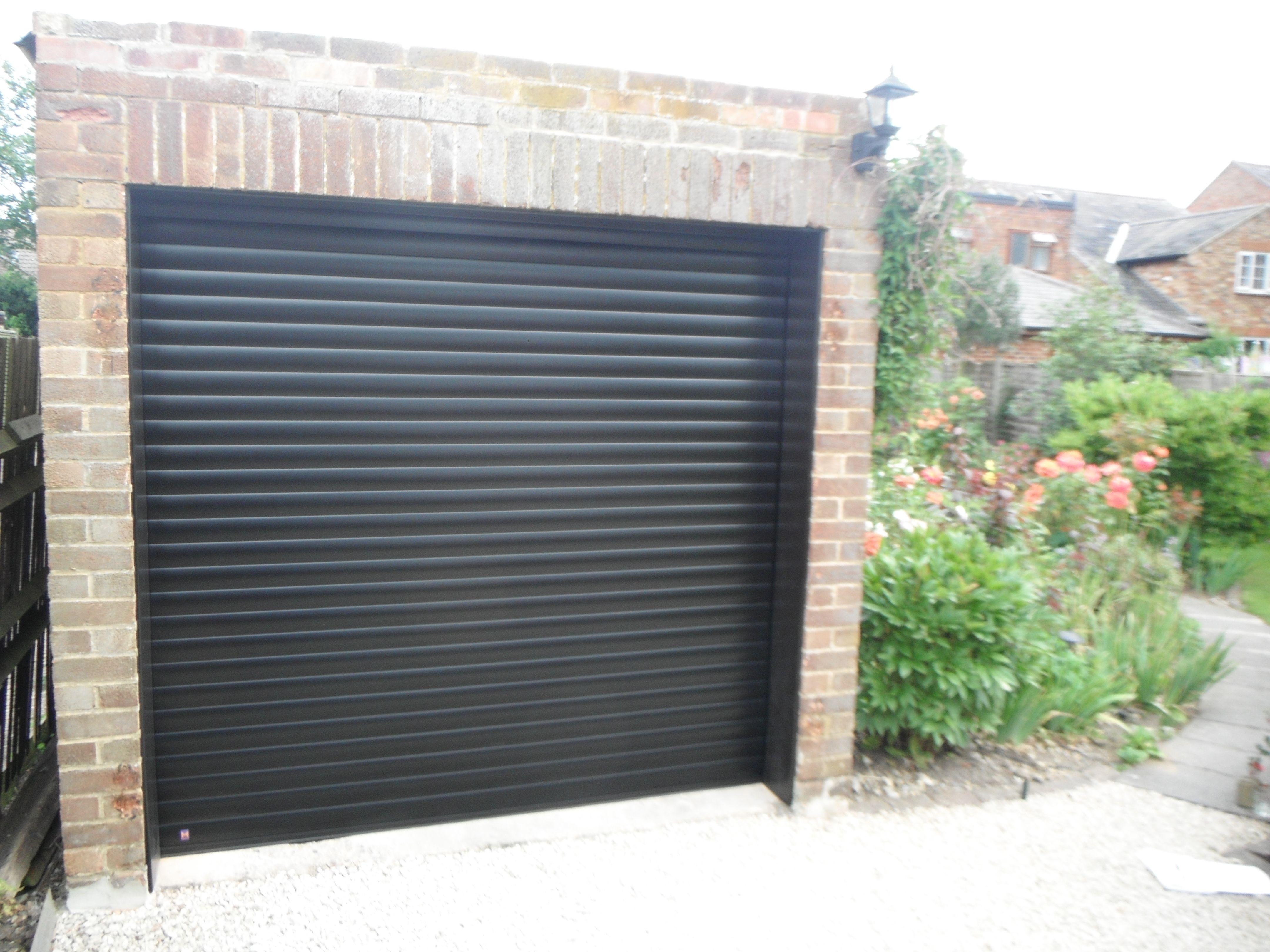 Hormann Rollmatic Garage Door in Jet Black finish.  sc 1 st  Pinterest & Hormann Rollmatic Garage Door in Jet Black finish. | Hormann ...