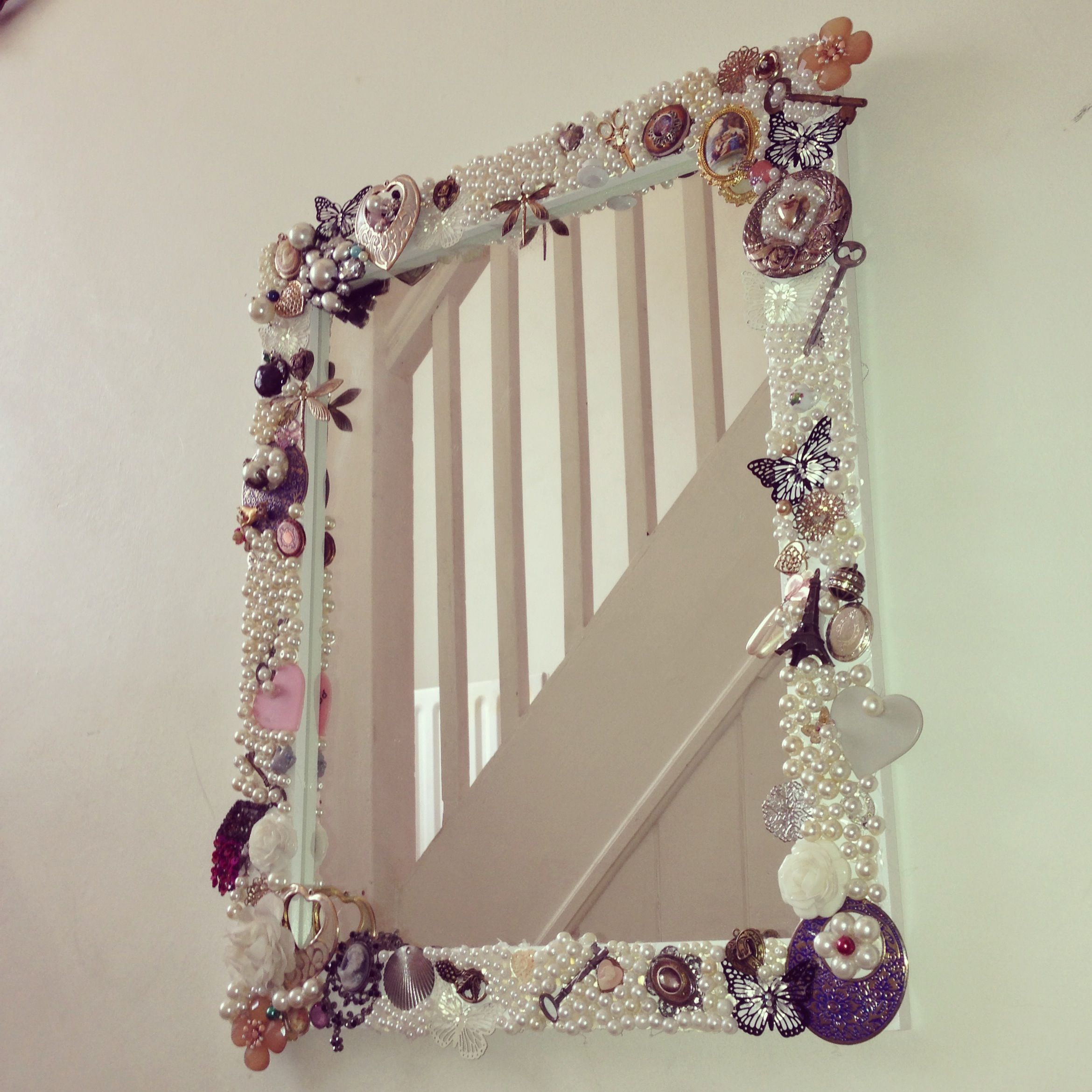 hand decorated mirror with broken jewellery and a glue gun