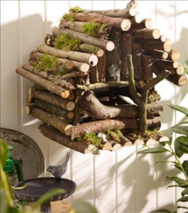 Use twigs to decorate your birdhouse and make your bird friends