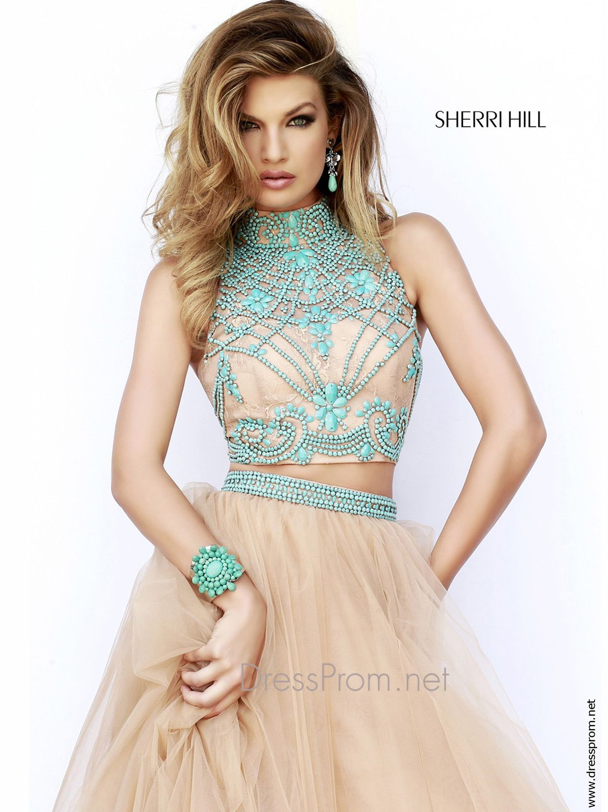 Make a statement wearing this spectacular two piece Sherri Hill prom dress. This two piece Sherri Hill prom dress 11225 features a high neckline, gorgeous fitted crop top bodice embellished with turquoise beading, and a tulle A-line skirt. The gorgeous skirt has a beaded waistband that highlights your natural waist. Finish this two piece Sherri Hill prom dress with stylish earrings and designer shoes at DressProm.net. Features: Silhouette: A-line Neckline: High Neckline Available in sizes…