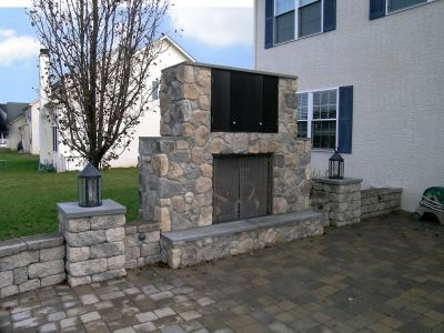 An outdoor ventless gas fireplace with an outdoor tv cabinet is a ...