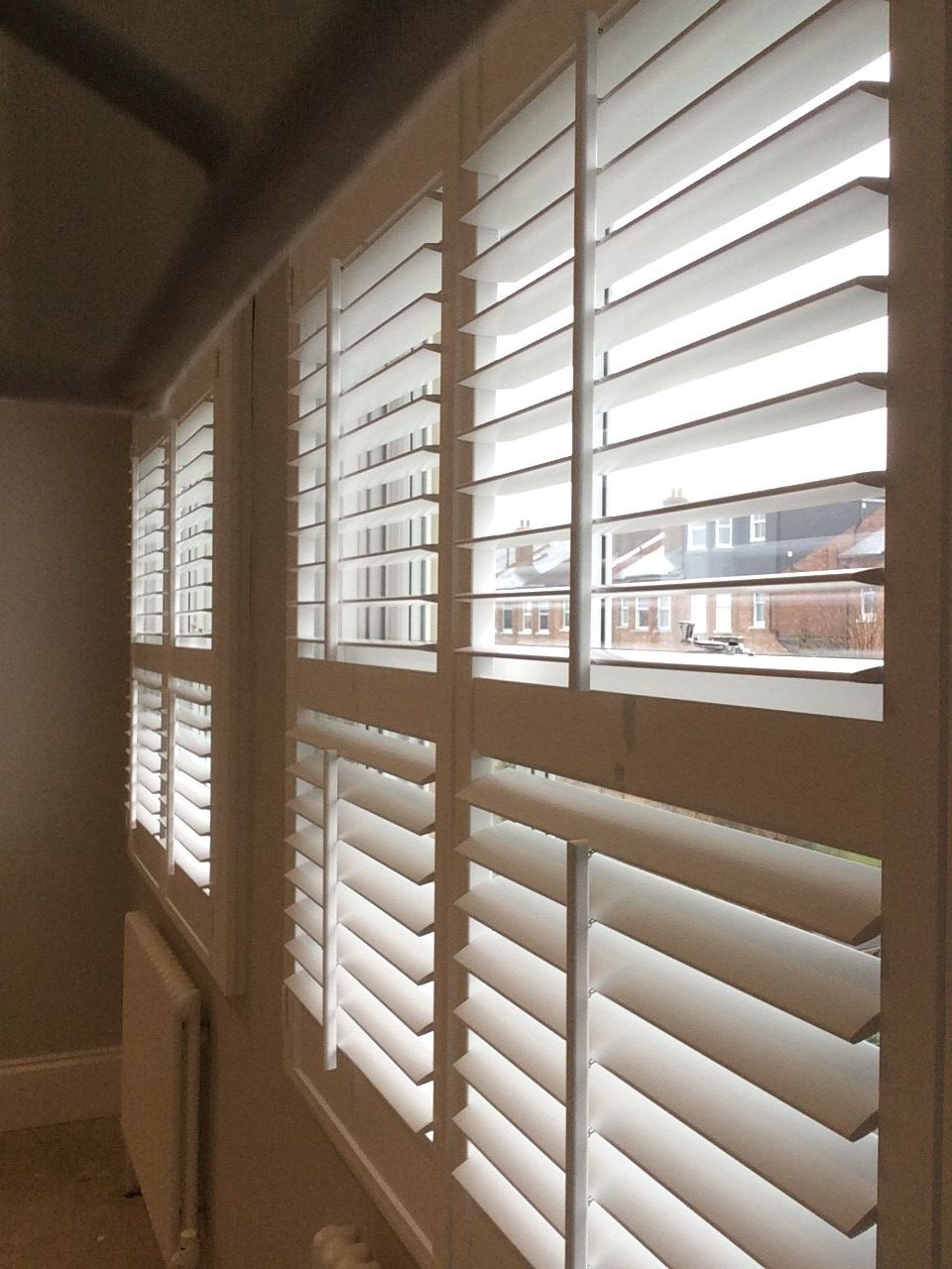 silk white shutters on a box sash window with 63mm louvres. Black Bedroom Furniture Sets. Home Design Ideas