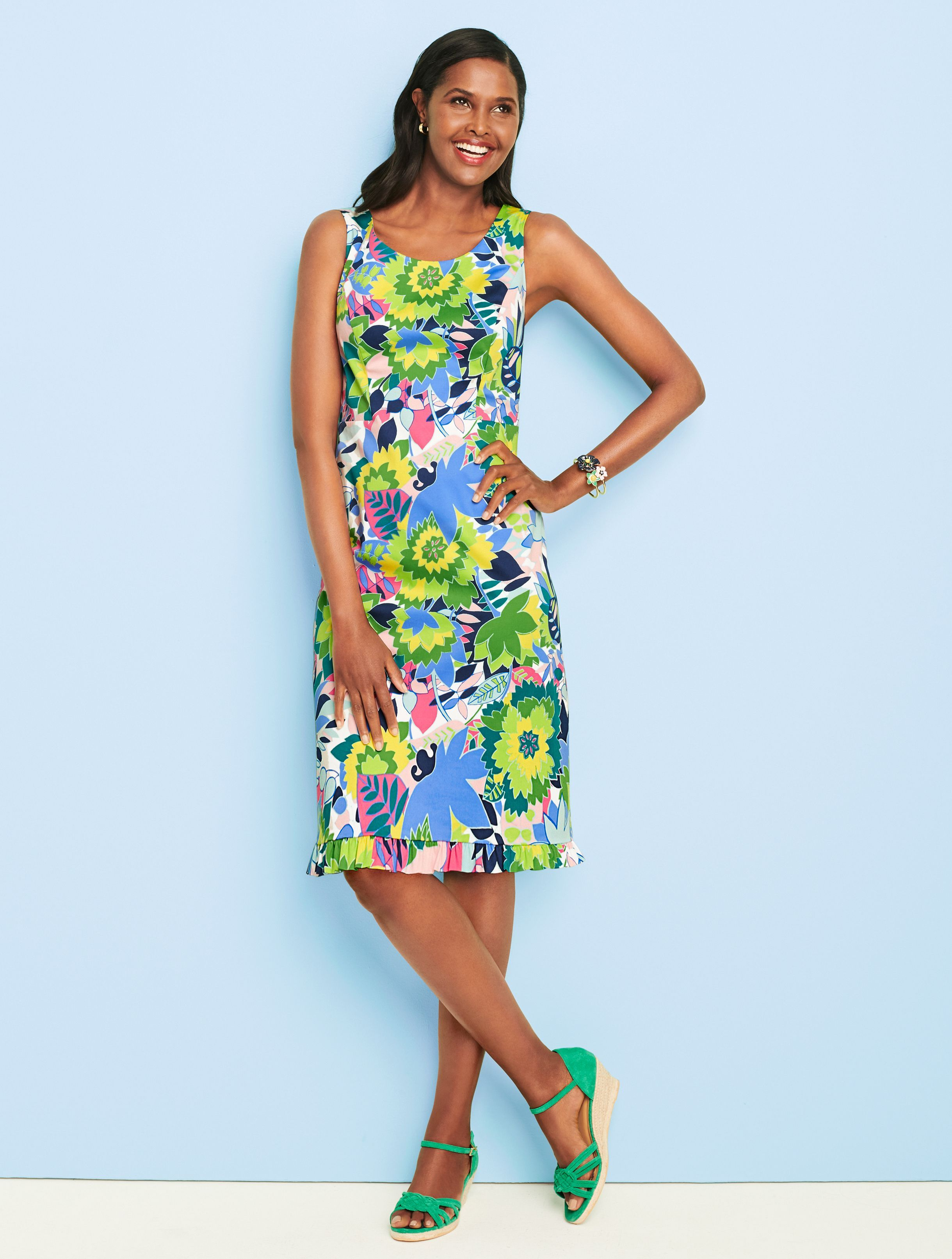 The Vibrant Palette And Soft Ruffle Hem Make This Dress