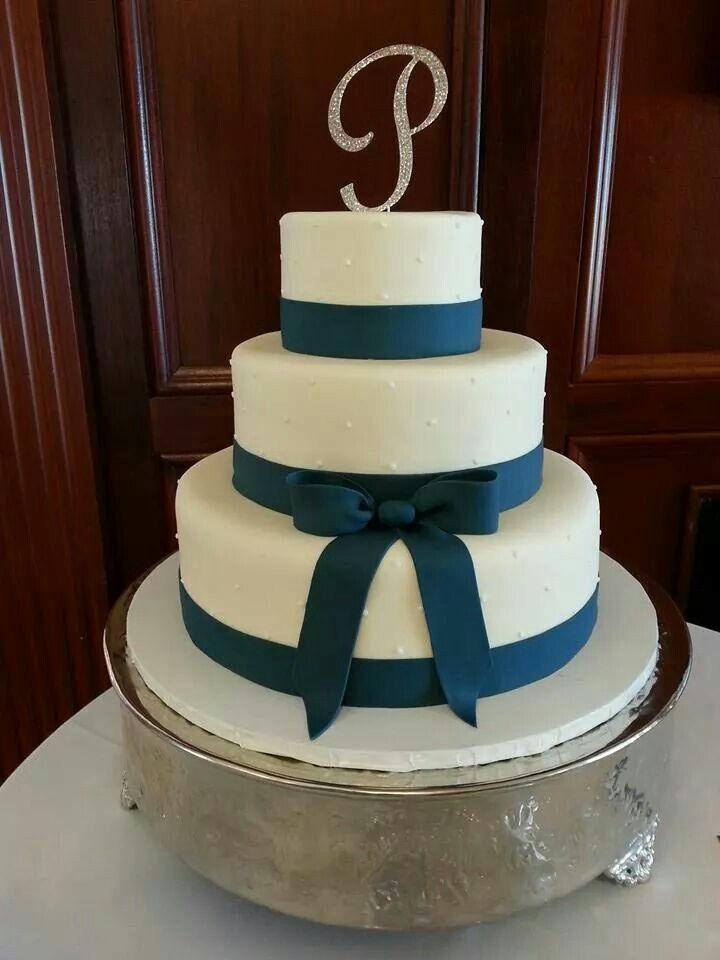 A Fondant Wedding Cake With Navy Blue Fondant Ribbon And Bow Swiss Dots And A Monogram Topper Wedding Cakes Wedding Cake Ribbon Tiered Wedding Cake