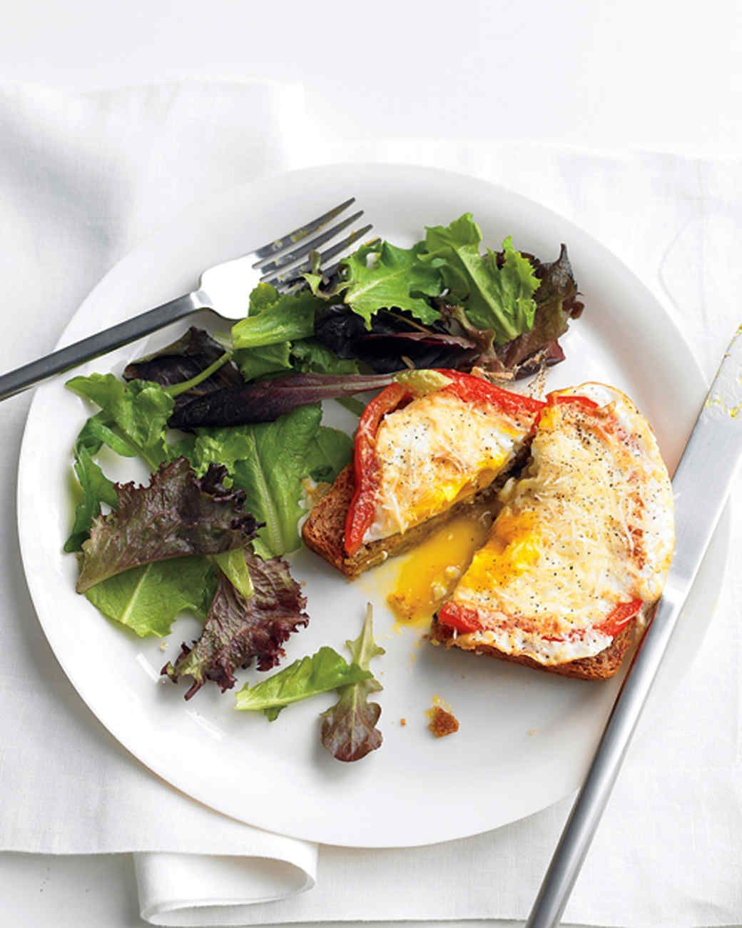 Bell Pepper Egg-in-a-Hole Recipe | Martha Stewart Living — We lightened up the classic egg-in-a-hole by swapping out the usual fried bread slices for fresh bell peppers and serving the whole thing on multigrain toast.