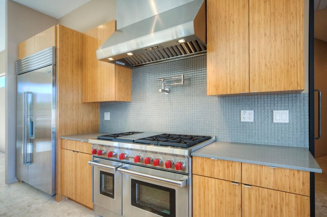 Onyx Property's kitchen with its bamboo cabinets and Wolf ...