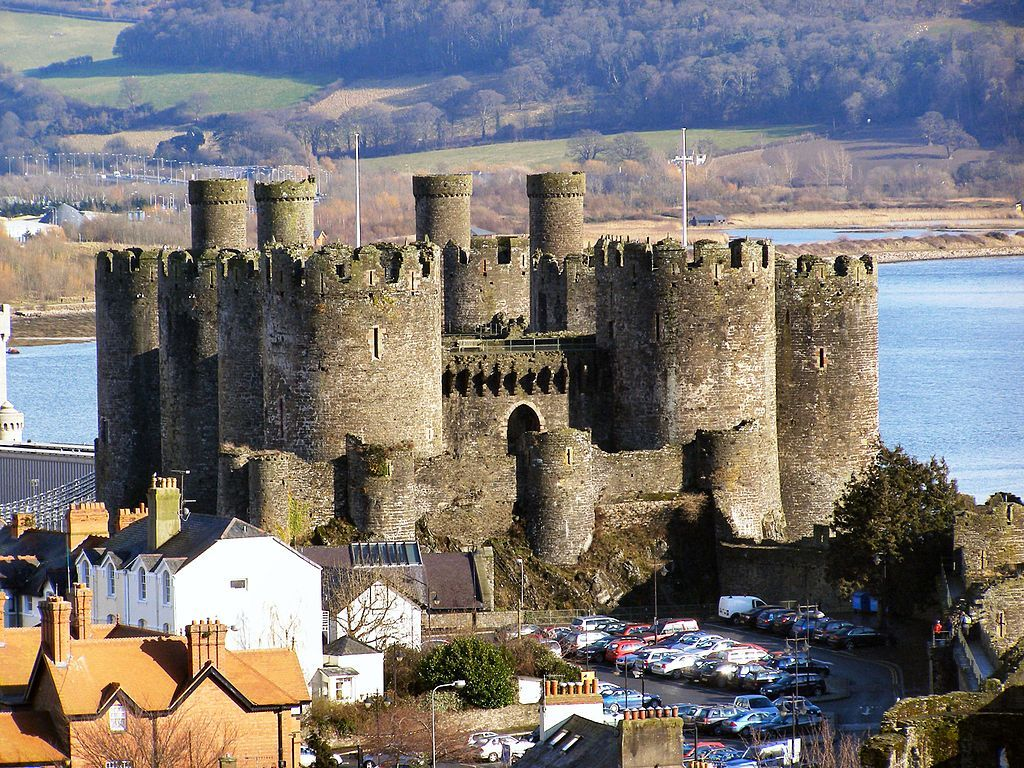Conwy Castle, Wales (Welsh: Castell Conwy, English: Conway Castle) is a medieval fortification in Conwy, on the north coast of Wales. It was built by Edward I, during his conquest of Wales, between 1283 and 1289.  Over the next few centuries, the castle played an important part in several wars. It withstood the siege of Madog ap Llywelyn in the winter of 1294–95, acted as a temporary haven for Richard II in 1399 and was held for several months by forces loyal to Owain Glyndŵr in 1401.