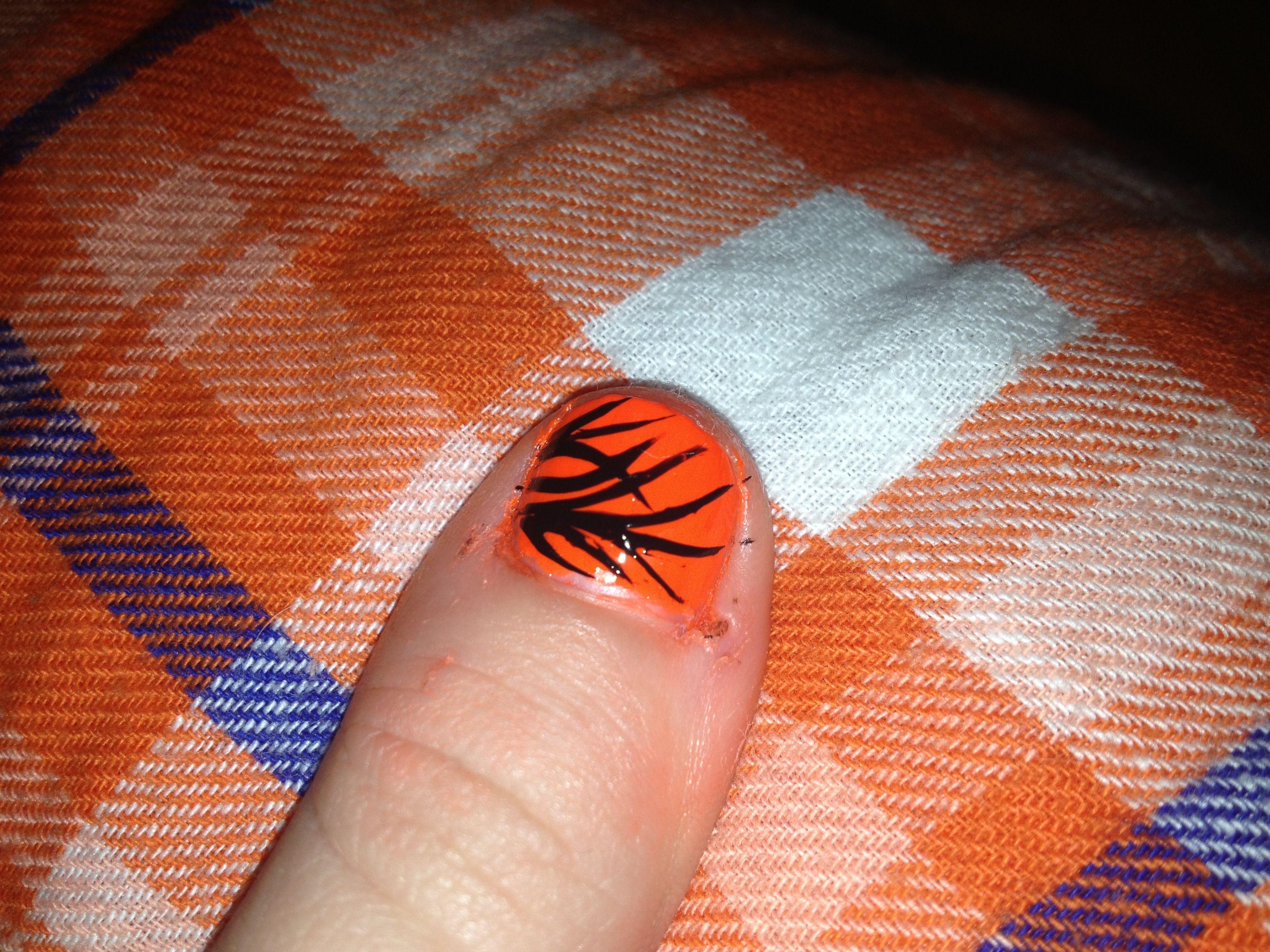 Black and orange nails