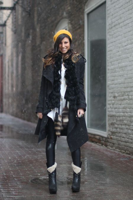 642b19057b65 black and white layered pieces topped off with a yellow beanie make this  look classic yet fun