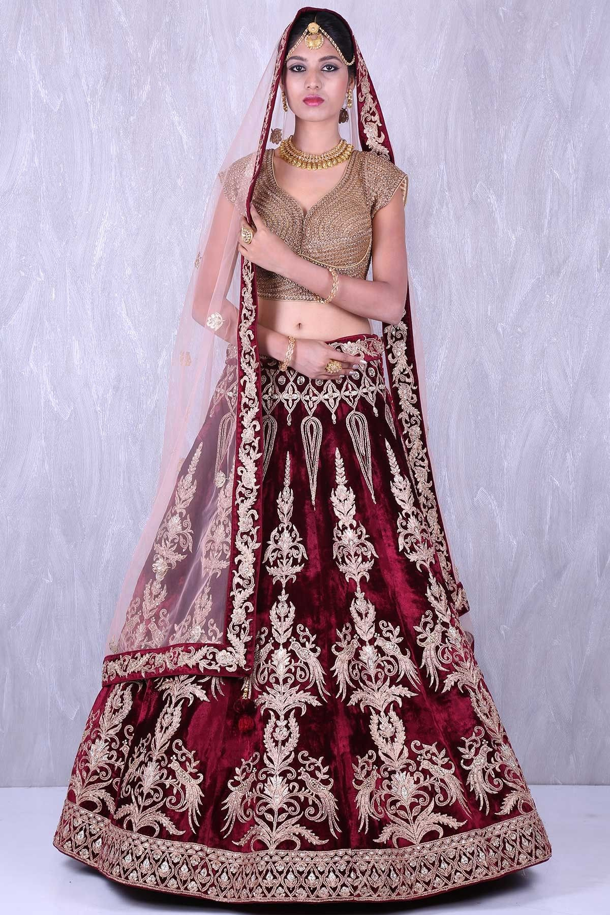 5355b05bc4 Buy Maroon & Gold enticing velvet lehenga with zardosi work Online #lehenga  #bridal #circular #indowestern #rawsilk #embroidered #zardosi #beads  #sequins ...