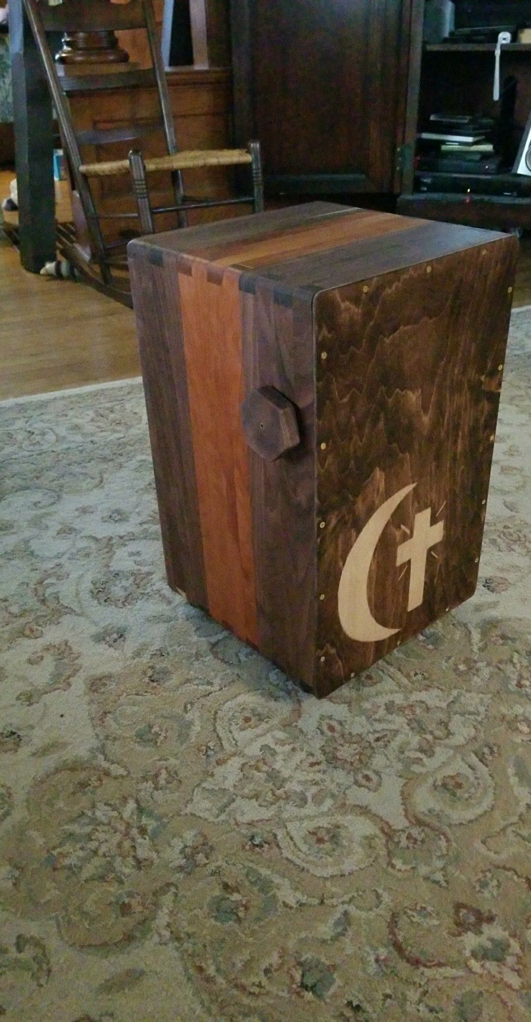 Homemade cajon with adjustable snare.