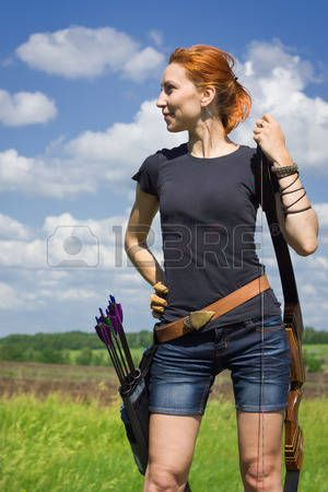 archery woman: Archery woman with a bow in the summer field