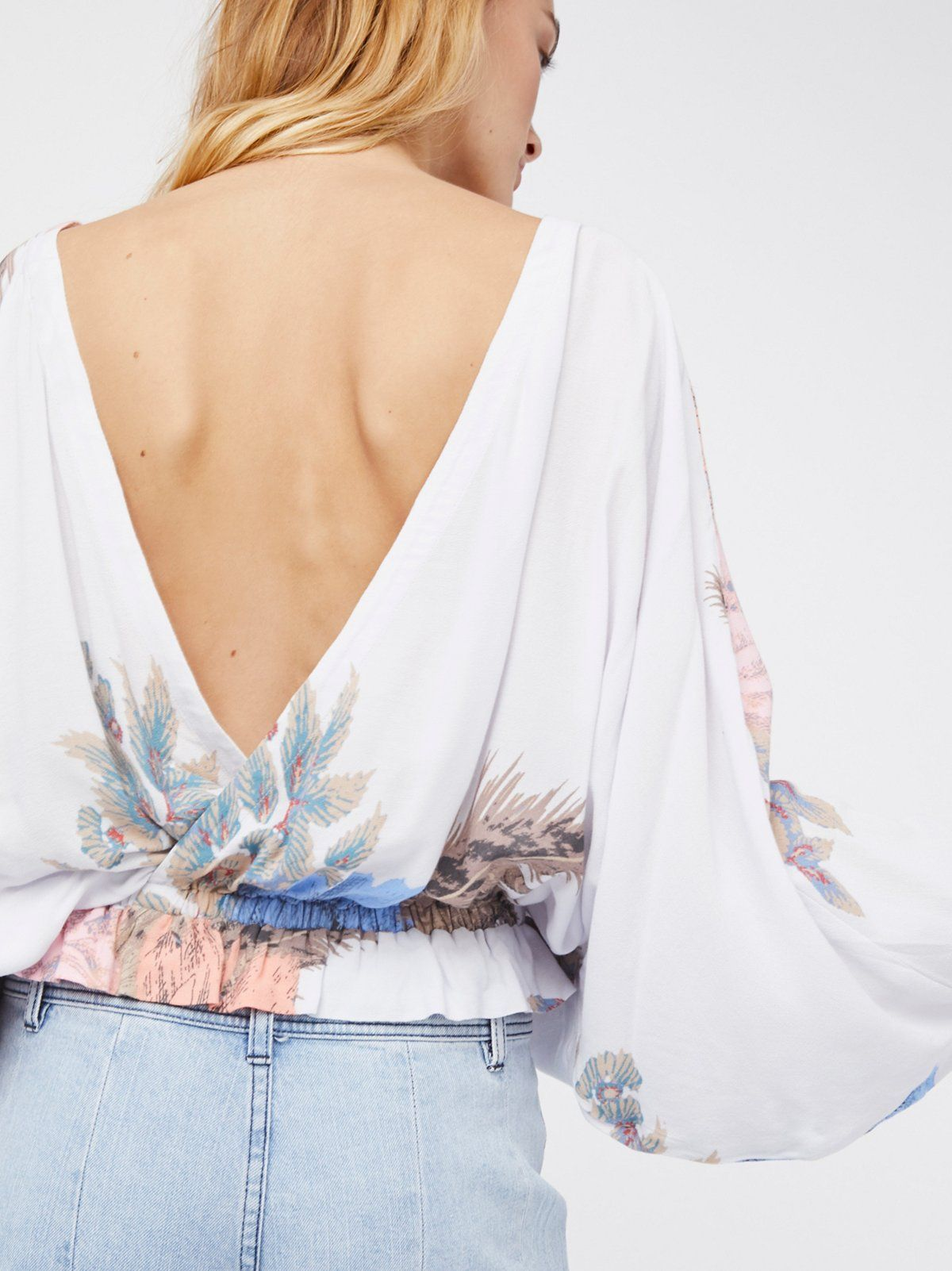 Lightweight printed top featuring an open surplice back.