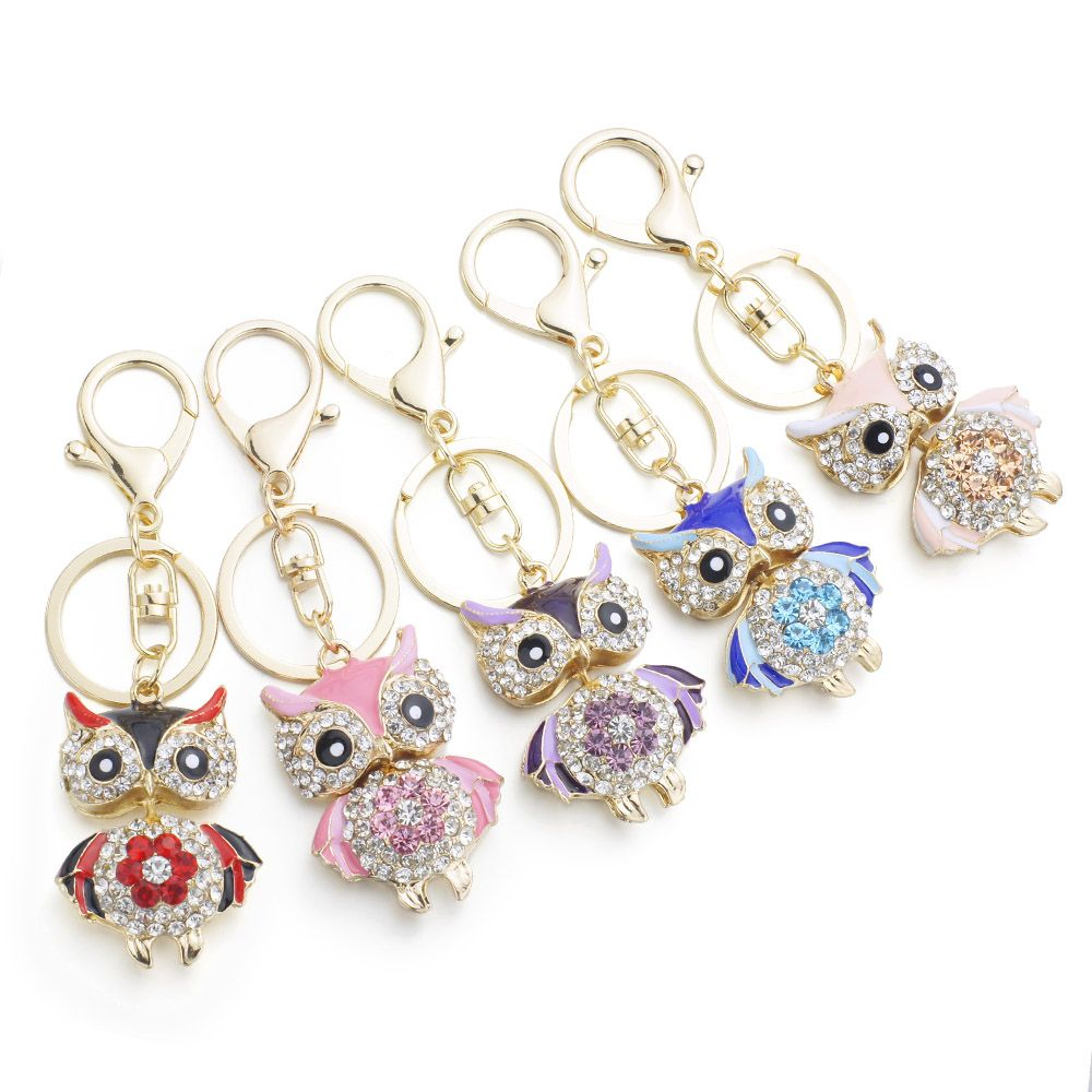 Cute Owl Crystal Keychain Bag Charm. We are giving a HUGE DISCOUNT on just 100 of these beautiful Cute Owl Crystal Keychain Bag Charm but only for a LIMITED TIME! These lovely owls look great hanging from your bag or decorating your keys! Charm Size: 2 x 1.6 inches / 5 x 4 cm. Colors: Red, Blue, Purple, Pink, Orange, Champagne.