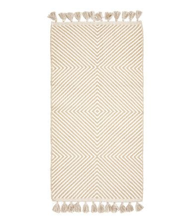 White Gold Colored Rug In Woven Cotton Fabric With Glittery Threads Tassels Along Short Sides Cotton Rug Rugs On Carpet Rugs
