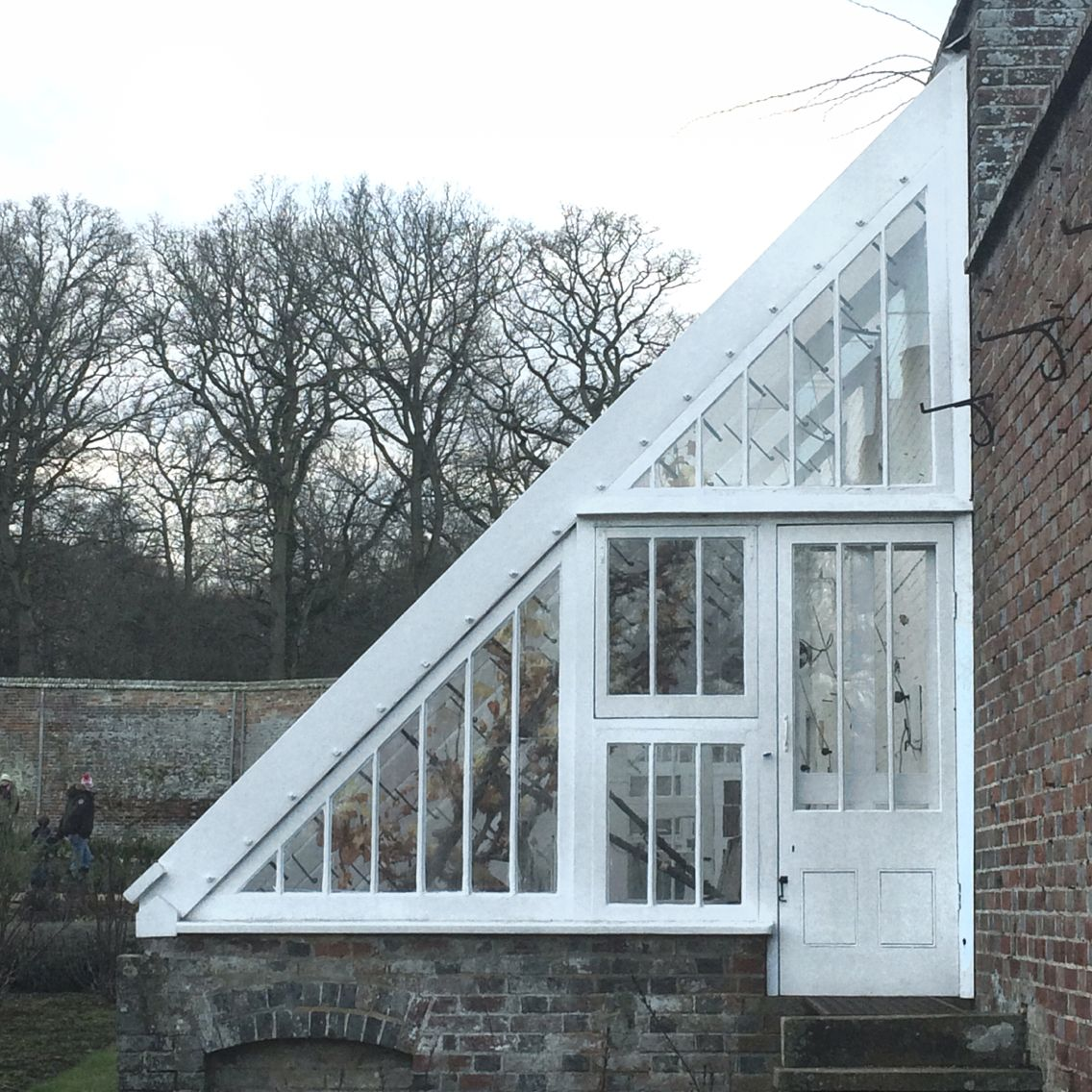 Greenhouse off shed with reclaimed / salvage windows. Good use of ...