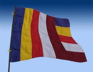 The six colors on the flag represent the aura that emanated from the body of the Buddha when He attained Enlightenment under the bodhi tree.  The horizontal stripes represent the races of the world living in harmony and the vertical stripes represent eternal world peace. Made in Kathmandu, Nepal.