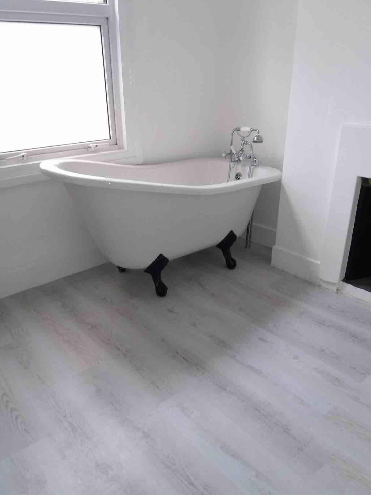Fitting Of Luxury Vinyl Tiles Lvt In Bathroom Area For Preparation