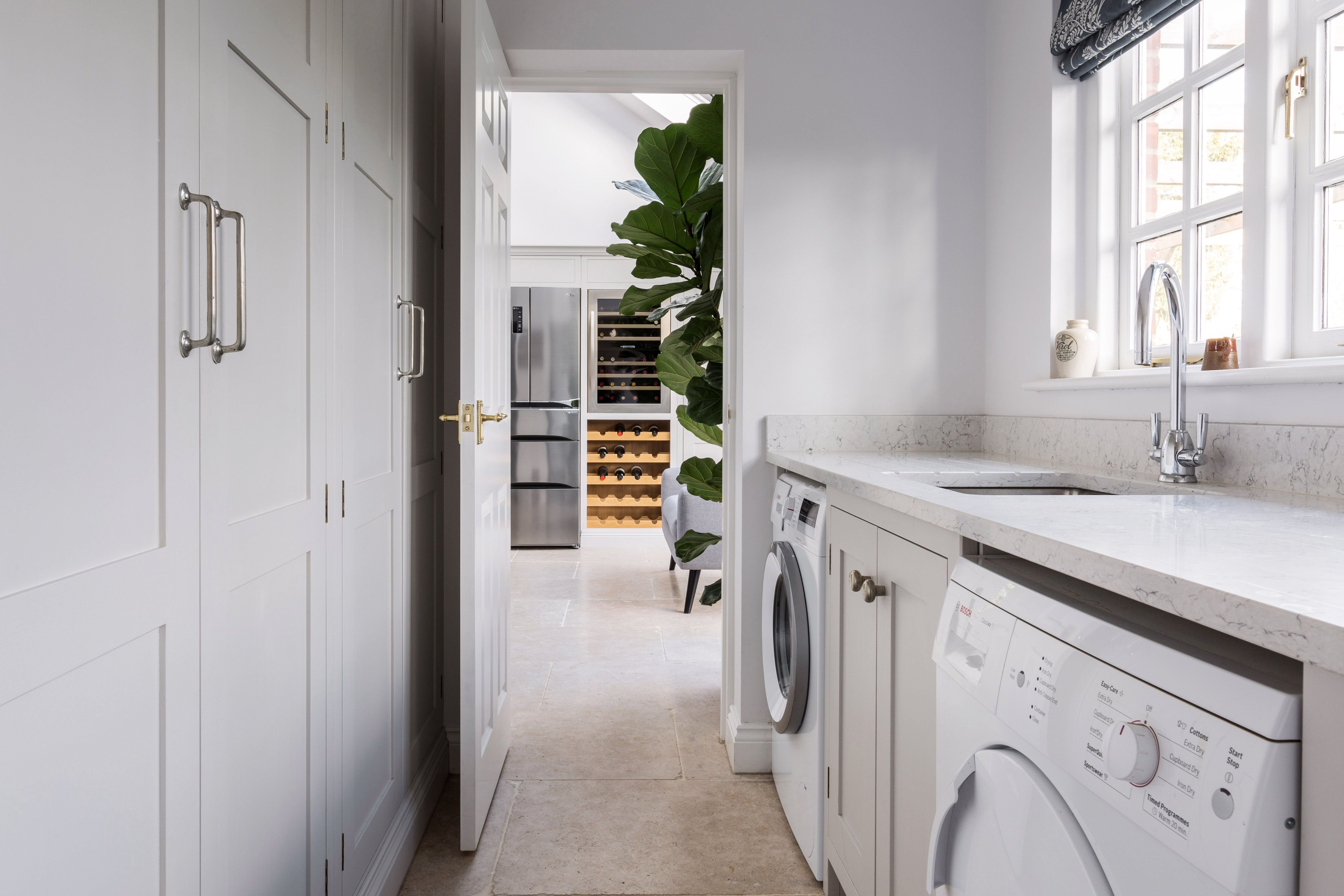 A Simple Run Of Floor To Ceiling Cabinets Provide Lots Of Needed Storage Space Utility Rooms Utility Room Designs Boot Room