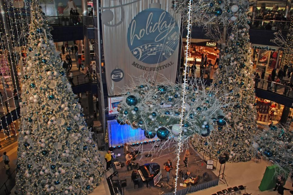 Come Winter Towering Trees And Twinkling Lights Take Over These Towns Explore 10 Places Across Am Outdoor Christmas Lights Christmas In America Holiday Decor