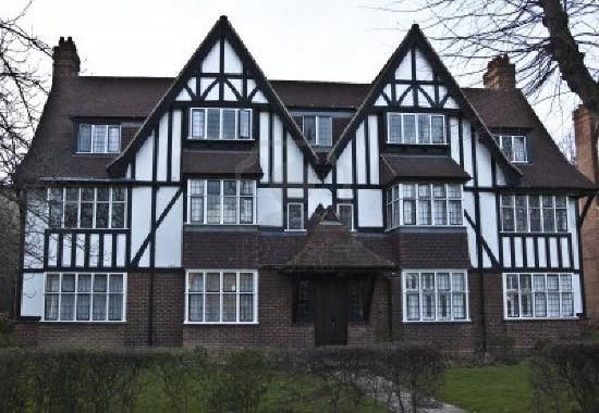 Architectural styles tudor house has 2 chimneys and has for House with lots of windows
