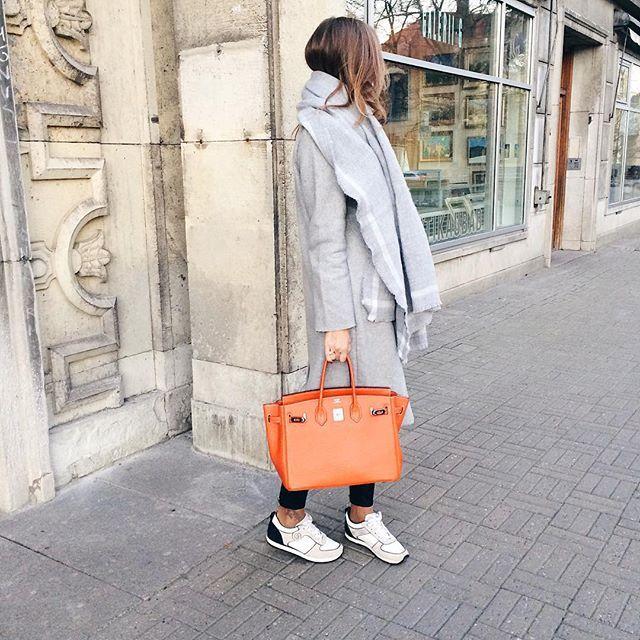 5e15f6ffeffc Orange hermes birkin bag winter outfit coat sneakers