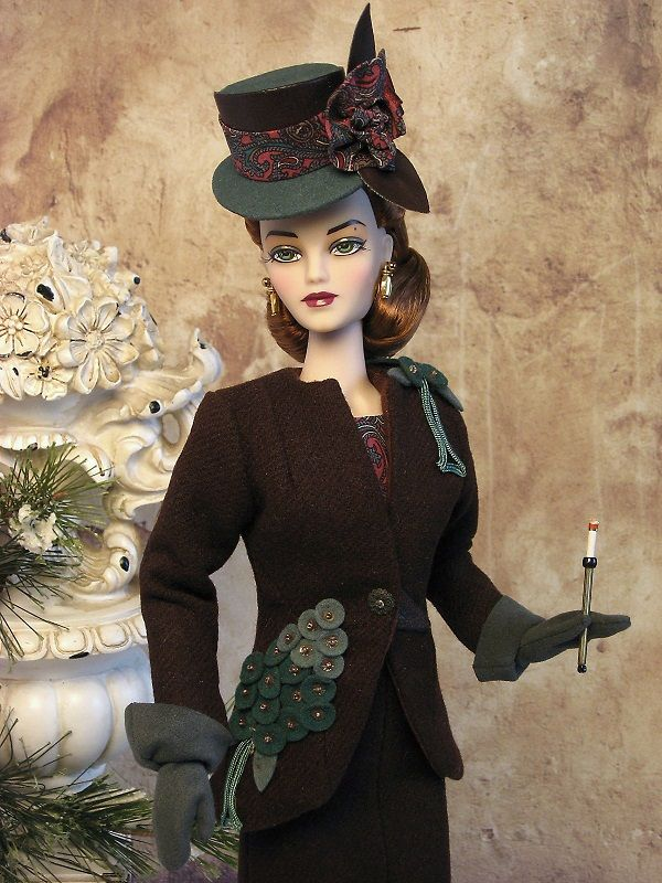 Vintage appliques accent a wool suit ensemble from The Couture Touch. Circa 1940's