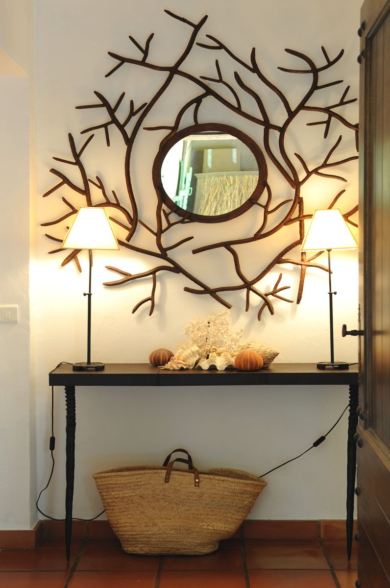 A contemporary wrought iron provincial mirror with an African ...