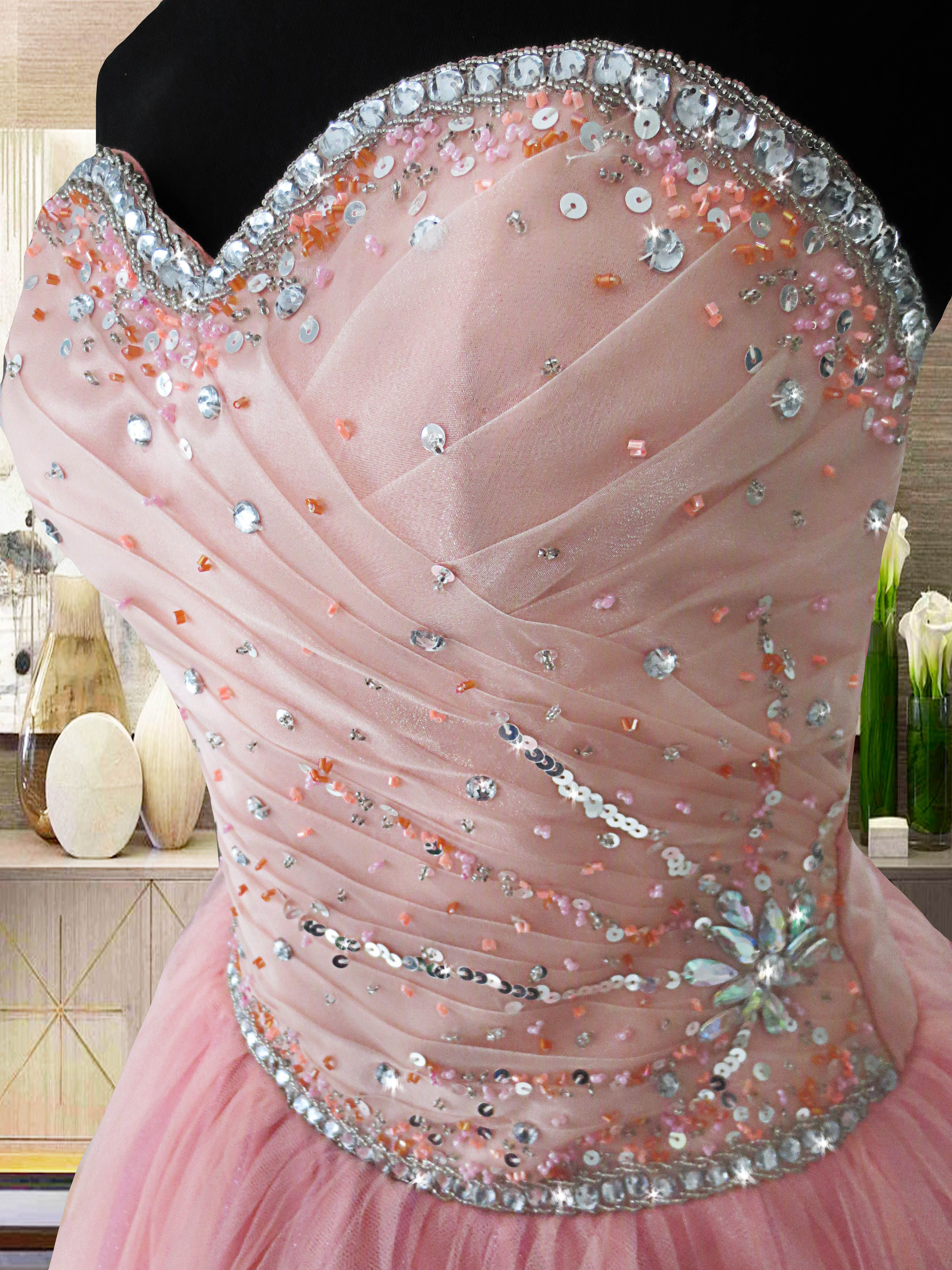 The Amelia gown is a pink-peach ball gown with crystals on its ...