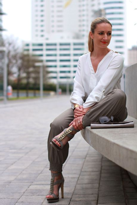 White blouse on armygreen trousers with heels