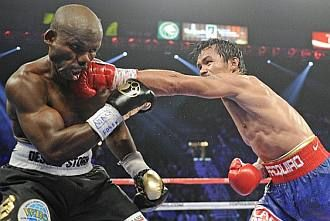 :::: THE NEW PACLAND: PINOYGREATS.COM :::: To get all the Manny Pacquiao news, sure its biased towards Pacman but its a fan site.