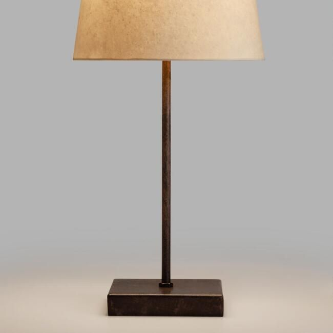 Any plain subtle goldish brassy or metal lamp base from world market but