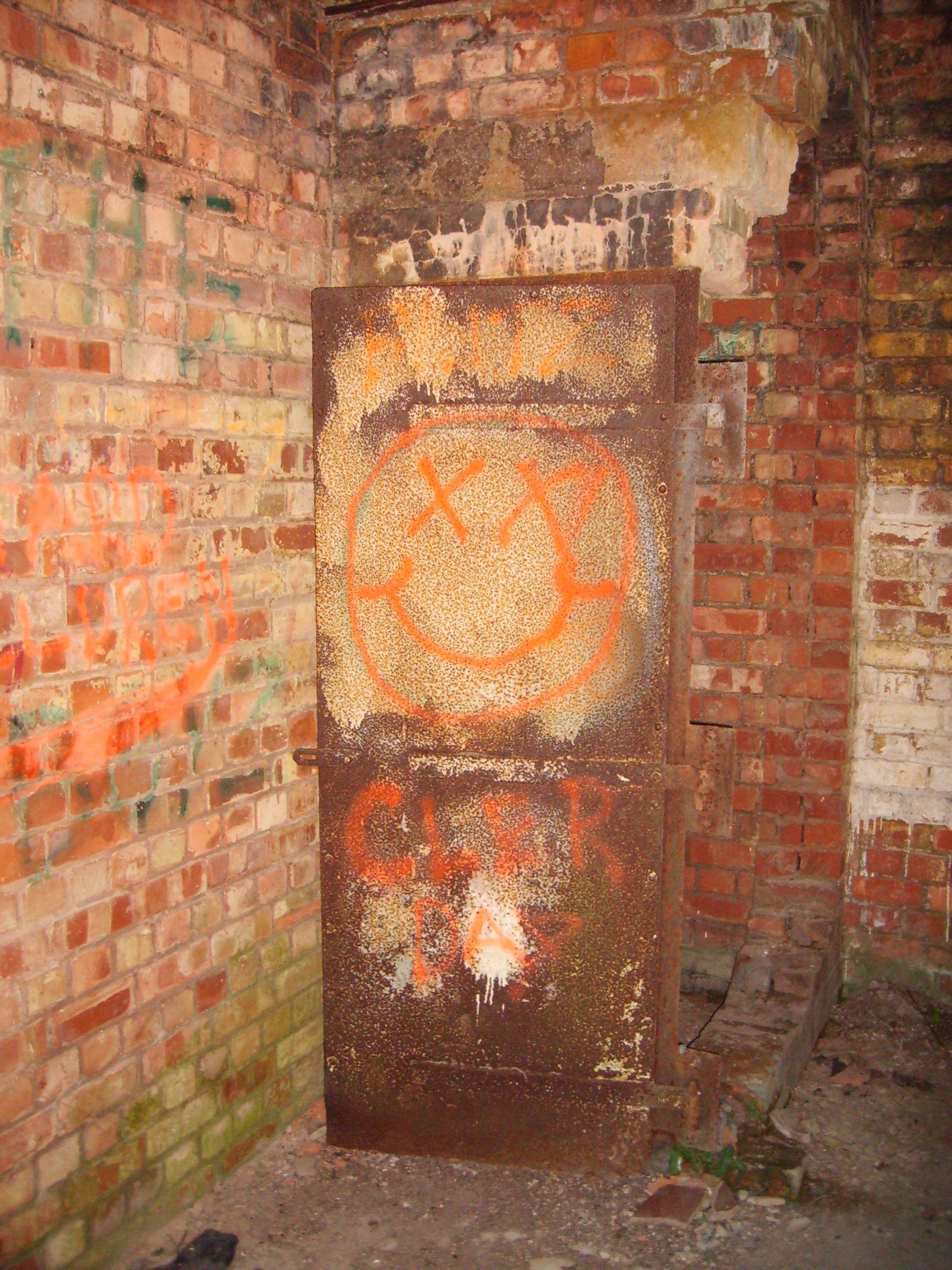Rusted iron door inside abandoned bunker