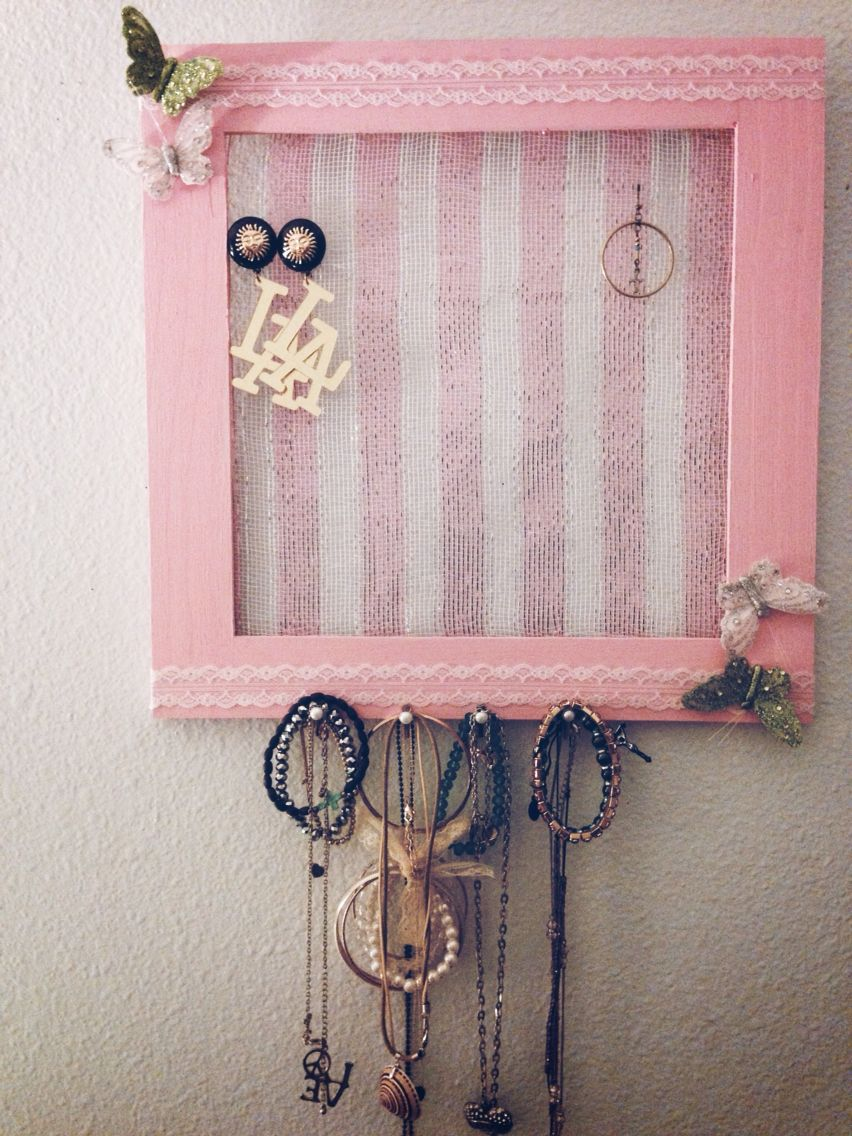 DIY jeweler wall holder ! Made with a cheap picture frame- hot glued tulle, and pearl thumb tacs. Painted and all done under 20$ !