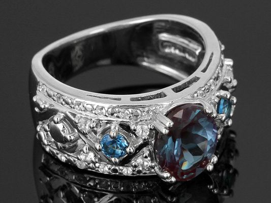 1.83ct Oval Lab Created Alexandrite, .24ctw London Blue Topaz With .68ctw White Topaz Silver Ring