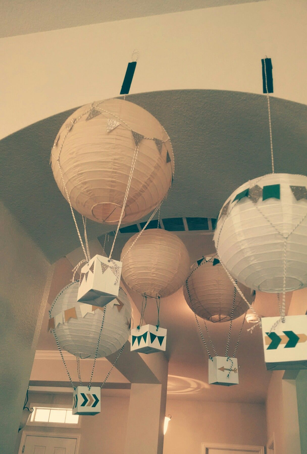 These are seriously the cutest DIY hot-air balloons I have ever seen! A talented mommy made these for an adventure themed baby shower!