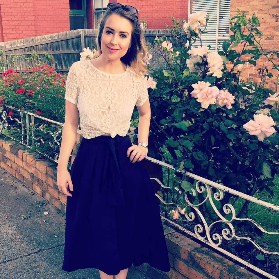 Black skirt and knotted lace tee