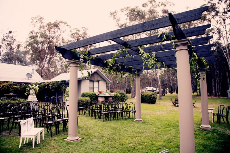Rebecca + Colby  Pergola with vines, Bentwood chairs