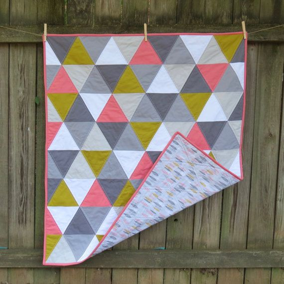 This cozy baby quilt was quilted in a straight-line pattern and made with 100% cotton. We used Warm & Natural batting, which is soft and natural