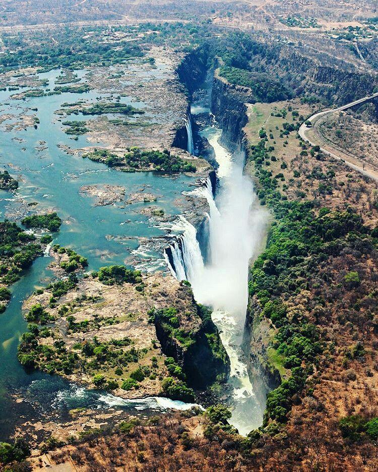 The magnificent Victoria Falls on the Zambezi River at the border of Zambia and…