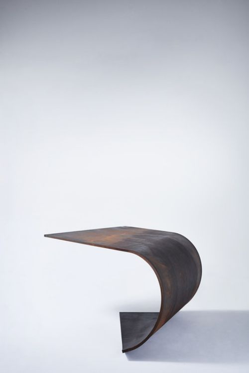 Bent Designer Steel Table Astonished With Perfect Balance